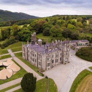 Amazing drone shot of Narrow water Castle with a six tipi doughnut set up in the estate gardens