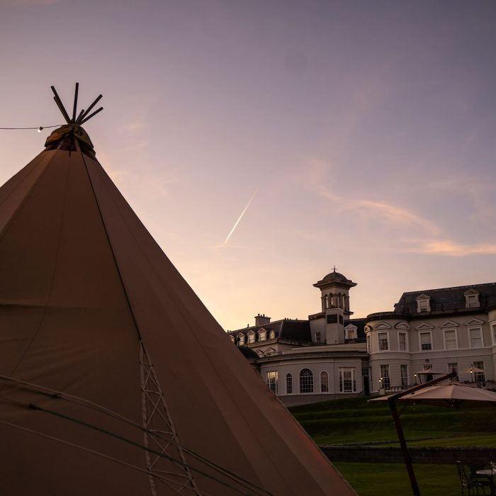 A Tipi sits in front of the K club, County Kildare at sunset