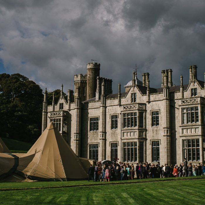 Guests arrive at a magnificent four tipi Wedding set up in front of Narrow Water Castle