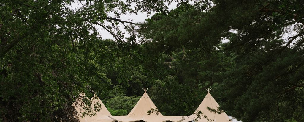 Four Tipis linked together with an open front ready to welcome wedding guests
