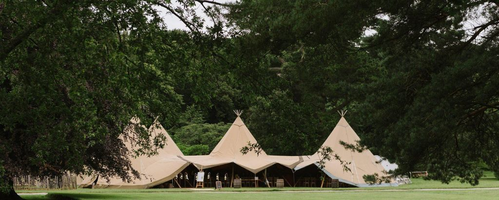 Mount stewart four tipi wedding setup on a green field