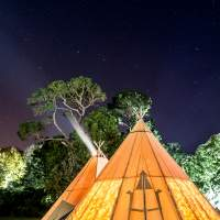 Two tipis are lit up under the stars at Mount Stewart's Festival of Light in Northern Ireland